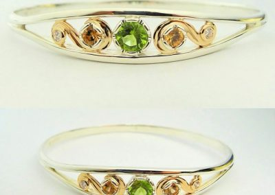 Silver and gold bangle with peridot, zircons and diamonds